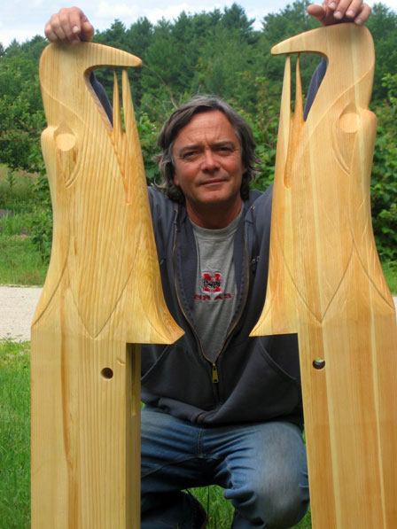 Tom McDermott with two hand carved wood eagles.