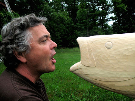 Tom McDermott with a hand carved fish.